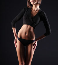 woman_sexy_abdomen_black_background